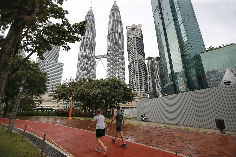 A view of people jogging at the KLCC park in Kuala Lumpur May 4, 2020. — Picture by Ahmad Zamzahuri