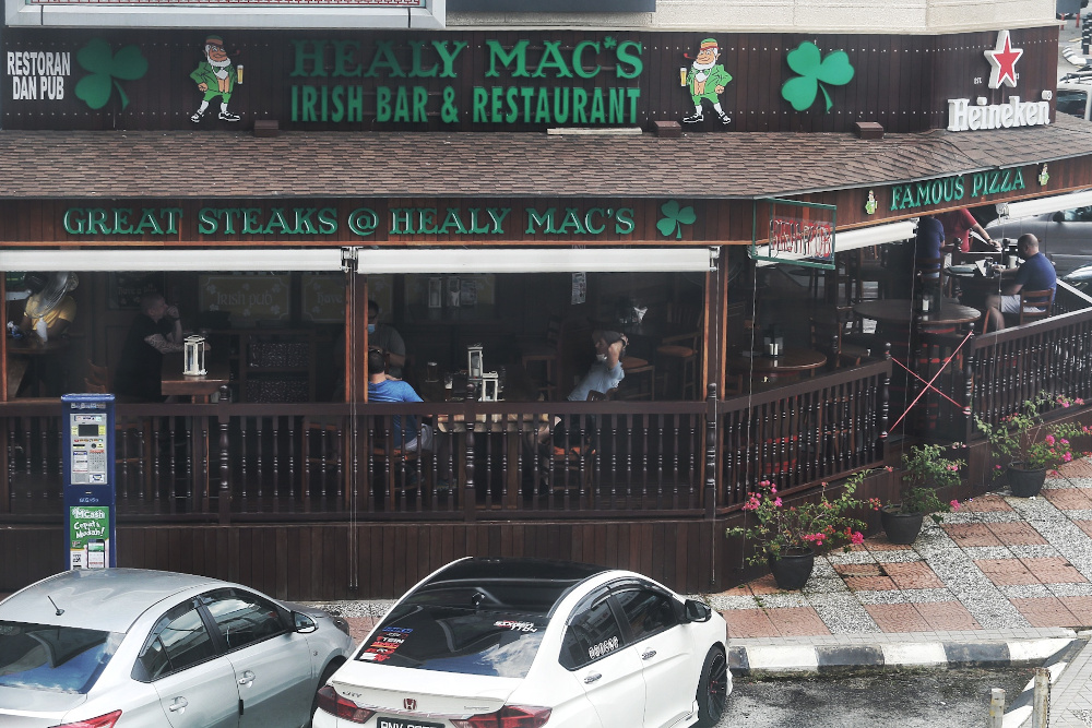 Diners dining in at Healy Mac's on the first day of CMCO May 4, 2020. Kuala Lumpur mayor Datuk Nor Hisham Ahmad Dahlan said that outlets with an entertainment licence such as pubs, bars and nightclubs would have to remain closed during the CMCO. — Picture by Choo Choy May