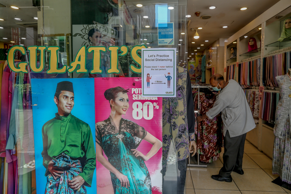 Gulati's Silk House does not need to worry about rent as it owns its premises, said Lavlu. — Picture by Firdaus Latif