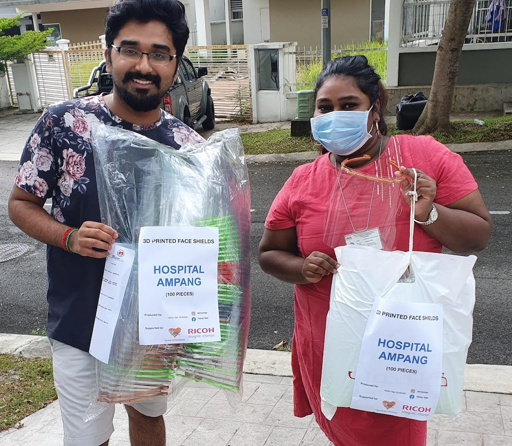 Vishan delivering 100 face shields to a volunteer to be distributed to Ampang Hospital. — Picture by Vishan Nair.