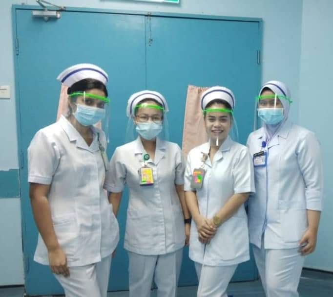 Nurses from Kuala Lumpur Hospital donning the face shields made by Vishan. — Picture by Vishan Nair.