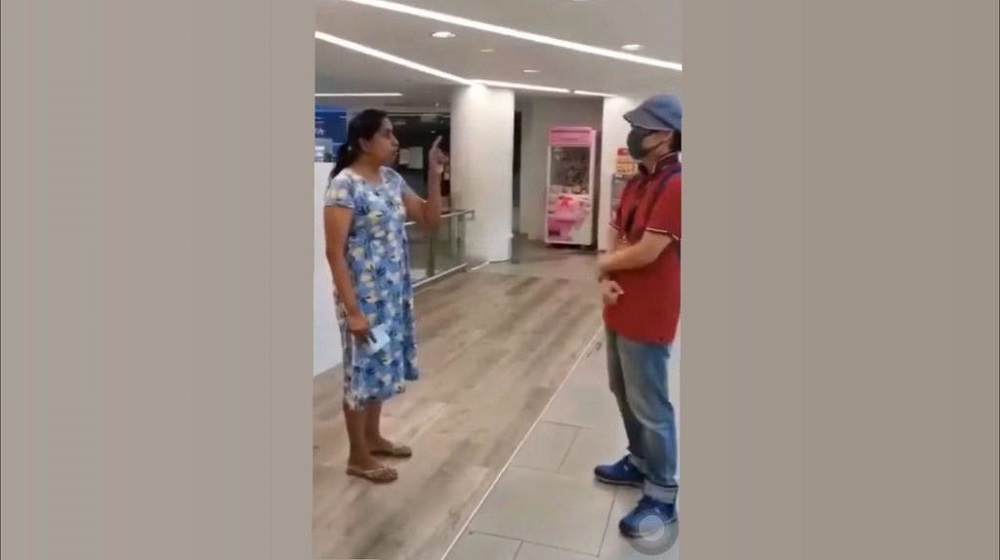 In the viral video, she was heard telling three men who confronted her: 'Remove your mask if you want to talk. No one can hear anything.' — Screen capture via Facebook/ Tiagong