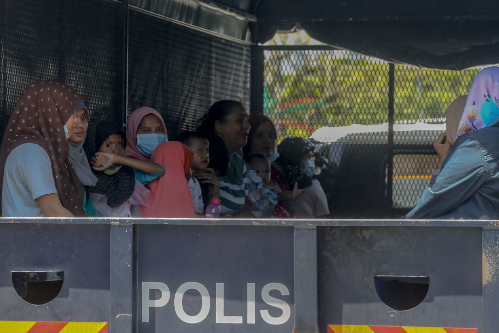 Some of the undocumented migrants at Selayang Baru that were arrested by the Immigration Department during a raid on May 14, 2020. — Picture by Firdaus Latif