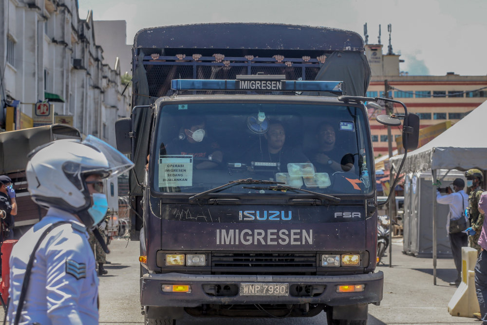 An Immigration Department truck is seen following raids against undocumented migrants carried out at Selayang Baru in Kuala Lumpur May 14, 2020. — Picture by Yusof Mat Isa