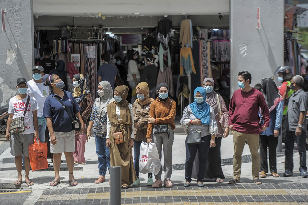 59 per cent of respondents said they felt confident for a future in Malaysia while 56 per cent expressed similar confidence for their family's future here.   — Picture by Shafwan Zaidon