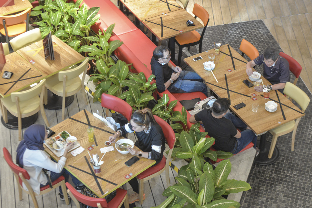 People are seen dining in as they practise social distancing at one of the shopping malls in Kuala Lumpur, May 26, 2020 — Picture by Shafwan Zaidon