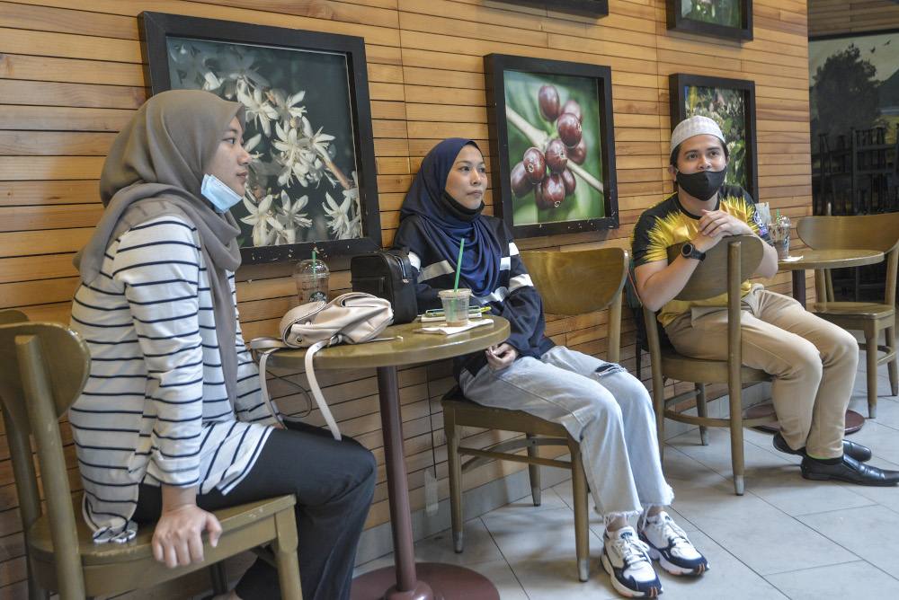 (From left) Wan Norfatin Afiqah Najwa, Nur Ajla and Muhammad Mu'adz speak to a reporter during an interview at Nu Sentral in Kuala Lumpur May 26, 2020 — Picture by Shafwan Zaidon