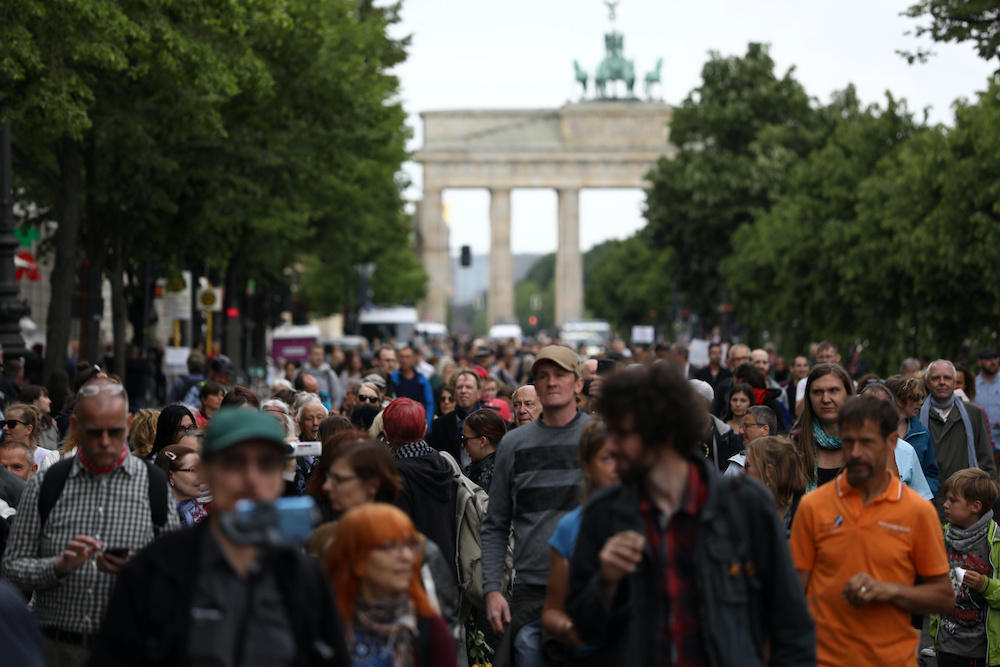 People attend a protest against the government's restrictions following the coronavirus disease (Covid-19) outbreak, in Berlin, Germany May 23, 2020. — Reuters pic