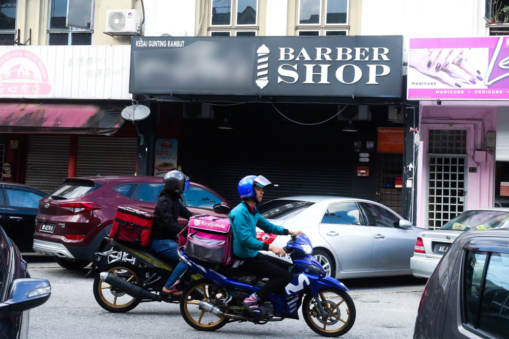 Barber shops in Subang closed during the conditional movement control order May 11, 2020. — Picture by Choo Choy May