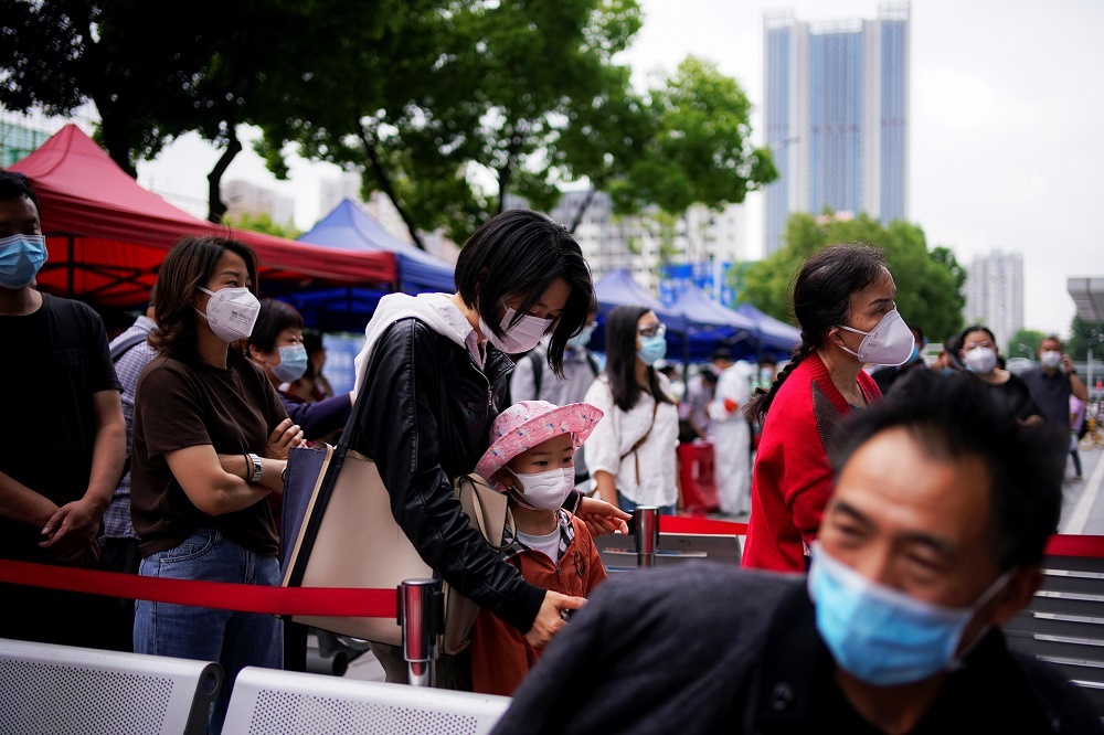 Residents wearing face masks queue for nucleic acid testings in Wuhan, the Chinese city hit hardest by the coronavirus disease outbreak, Hubei province, China May 16, 2020. ― Reuters pic
