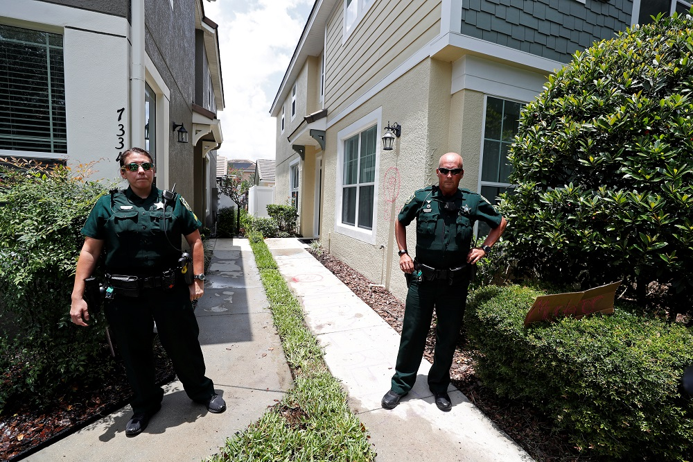 Police officers stand outside the Florida home of former Minneapolis police officer Derek Chauvin in the Windermere neighbourhood of Orlando May 29, 2020. ― Reuters pic