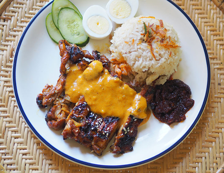 Creamy sauce with spices paired with a piece of 'ayam bakar' are the winners for this Nasi Lemak Ayam Bakar NALE order