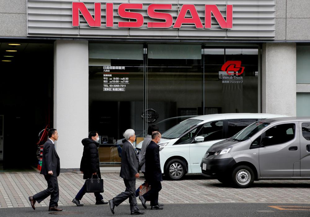 People walk past a dealer shop of Nissan Motor in Tokyo, Japan, February 12, 2019. — Reuters pic