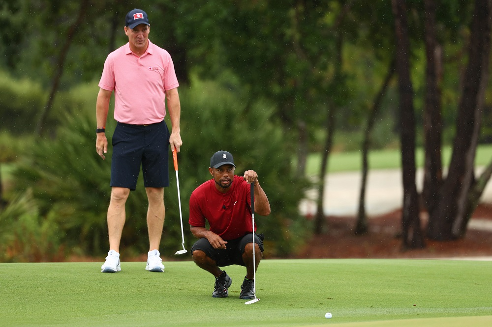 Tiger Woods and former NFL player Peyton Manning read a putt on the sixth green during The Match: Champions for Charity golf round at the Medalist Golf Club. ― Handout photo by Getty Images for The Match via USA TODAY Sports/Reuters