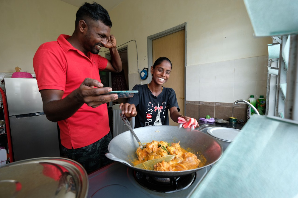 S. Pavithra and her husband M. Sugu record a YouTube video for their biryani rice recipe at their home in Sungai Siput May 8, 2020. — Bernama pic