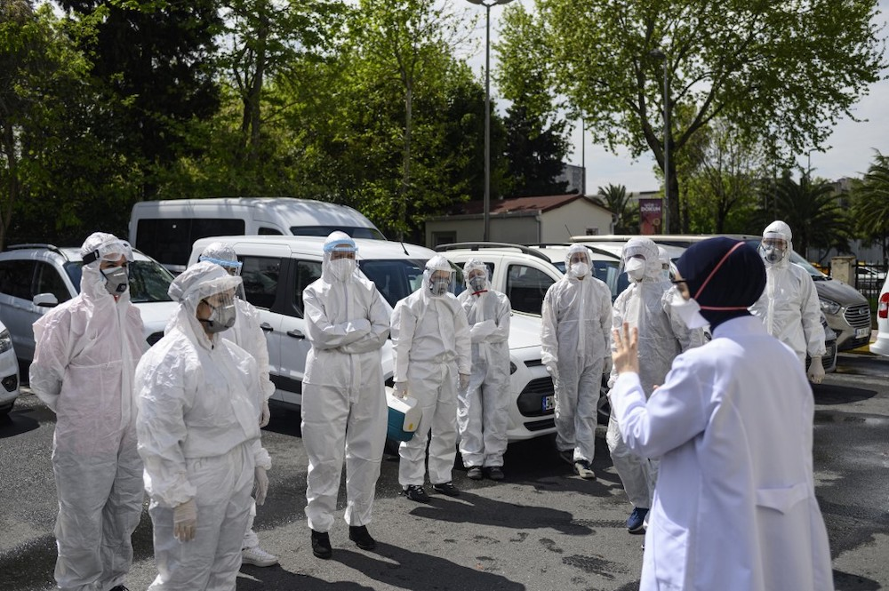 Head of Fatih District Health Department Melek Nr Aslan (right) briefs her staff before they leave to collect swab samples from confined people who are believed to have been in contact with coronavirus patients, in Istanbul on May 7, 2020. In Istanbul. �