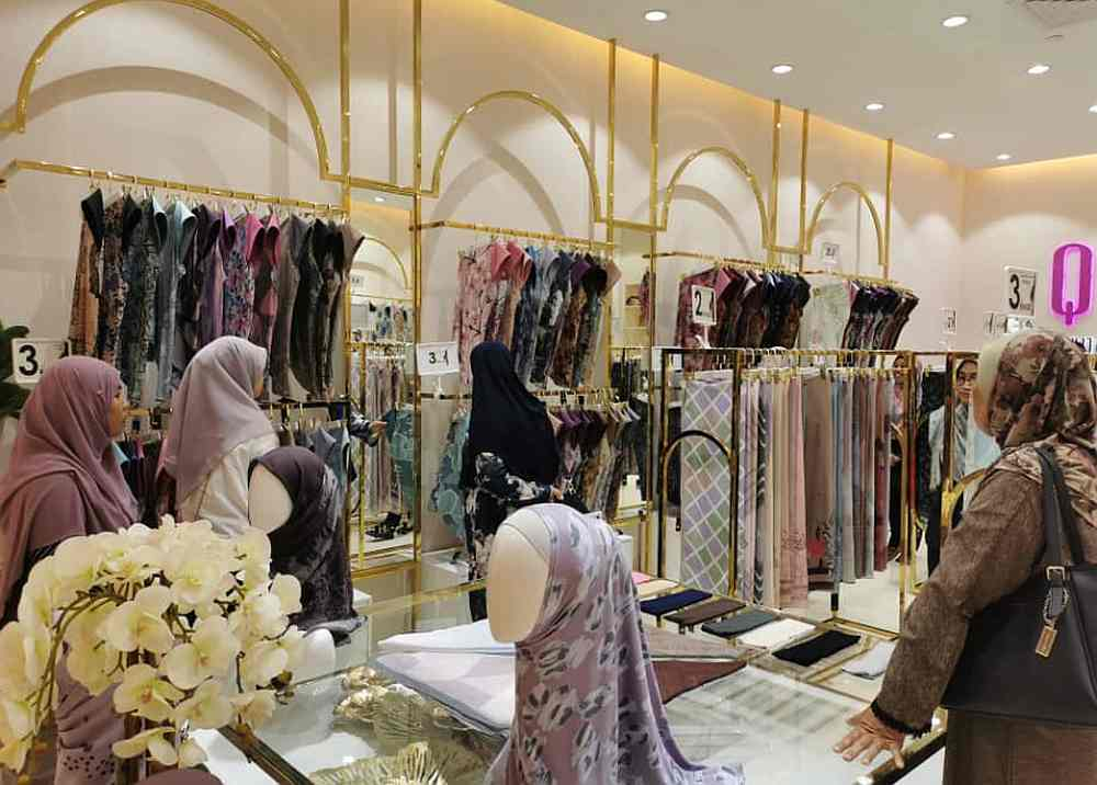 Muslim apparel stores are working hard to push sales during this Raya season, with customers reluctant to go out shopping. — Picture courtesy of Qaira Holdings Sdn Bhd