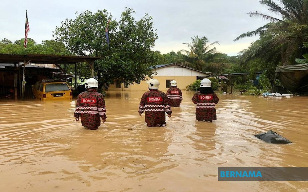 Fire and Rescue Department personnel provide assistance to residents during a flood in Penang May 17, 2020. — Picture via Twitter/Bernama
