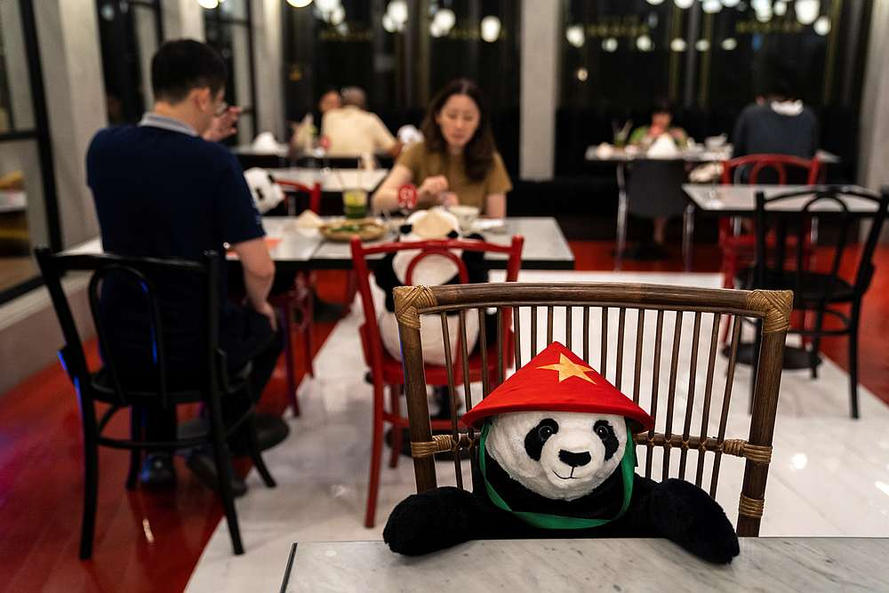 People have dinner as they sit next to stuffed panda dolls, used as part of social distancing measures, at the Maison Saigon restaurant in Bangkok, Thailand May 13, 2020. — Reuters pic
