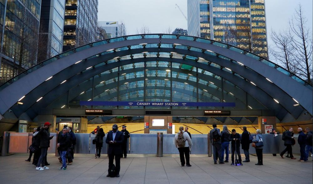 Commuters are seen outside a closed Canary Wharf tube station following an incident at the station in London, Britain, January 7, 2019. — Reuters pic