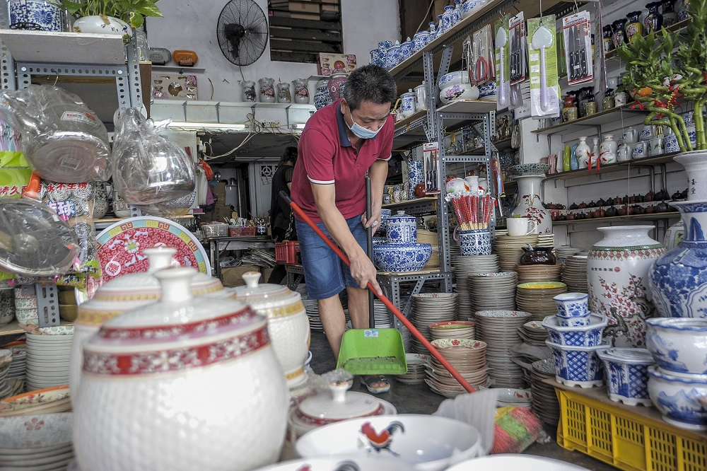 Chan Kan Woh, of Chi Shang Mei Enterprises, is seen cleaning his shop on Petaling Street May 4, 2020. ― Picture by Shafwan Zaidon