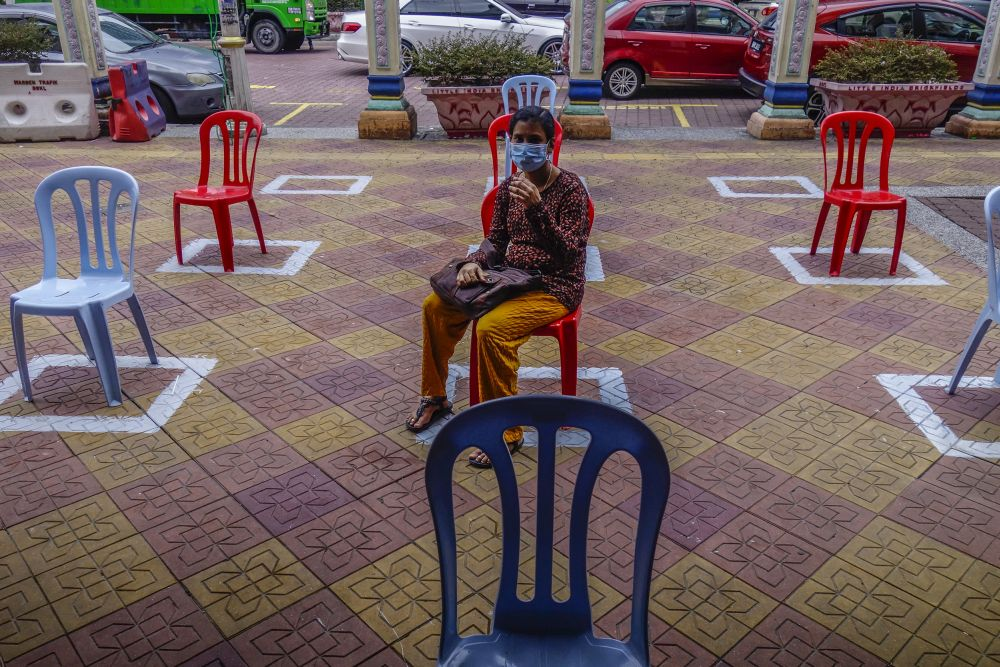 A woman adheres to social distancing guidelines in Kuala Lumpur May 12, 2020.— Picture by Shafwan Zaidon