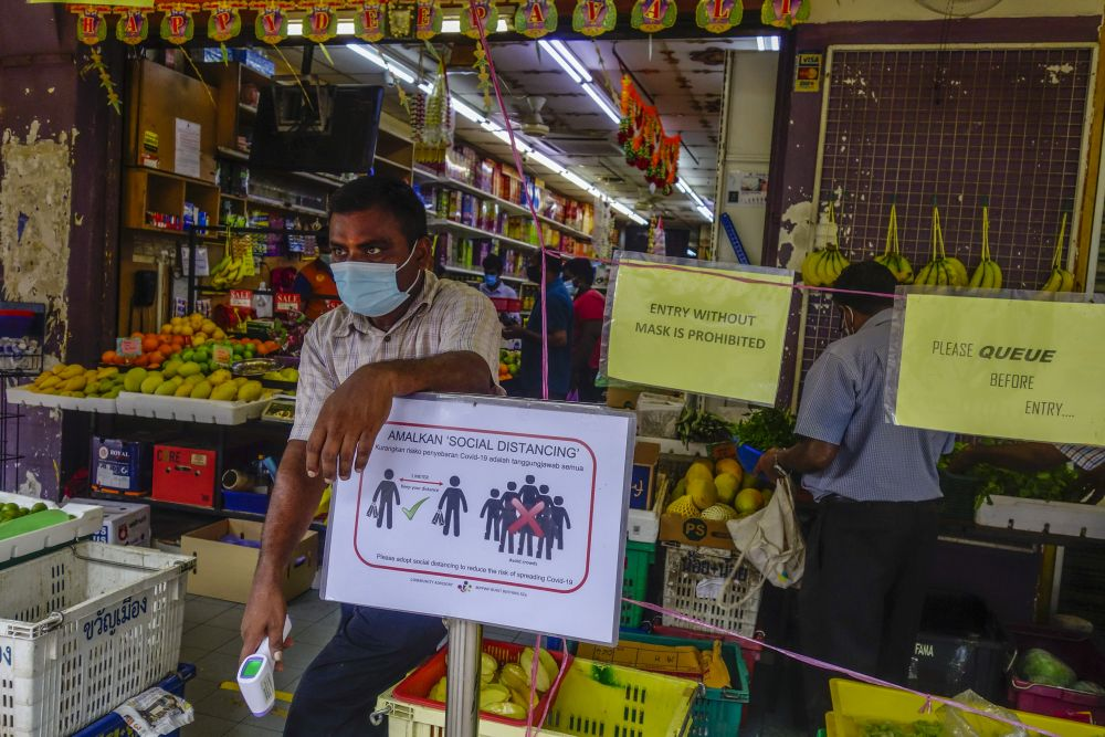 Notices detailing standard operating procedures during the conditional movement control order are displayed at the entrance of a sundry shop in Kuala Lumpur May 12, 2020.— Picture by Shafwan Zaidon