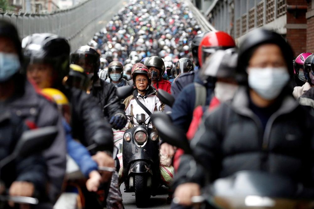 Commuters wear face masks to protect themselves from the coronavirus disease (Covid-19) spread during morning rush hour traffic in Taipei, Taiwan April 8, 2020. — Reuters pic