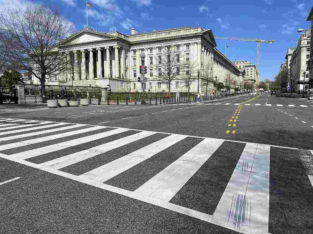 The US Treasury Department building is seen next to an almost empty 15th Street at noon in Washington March 13, 2020. — AFP pic