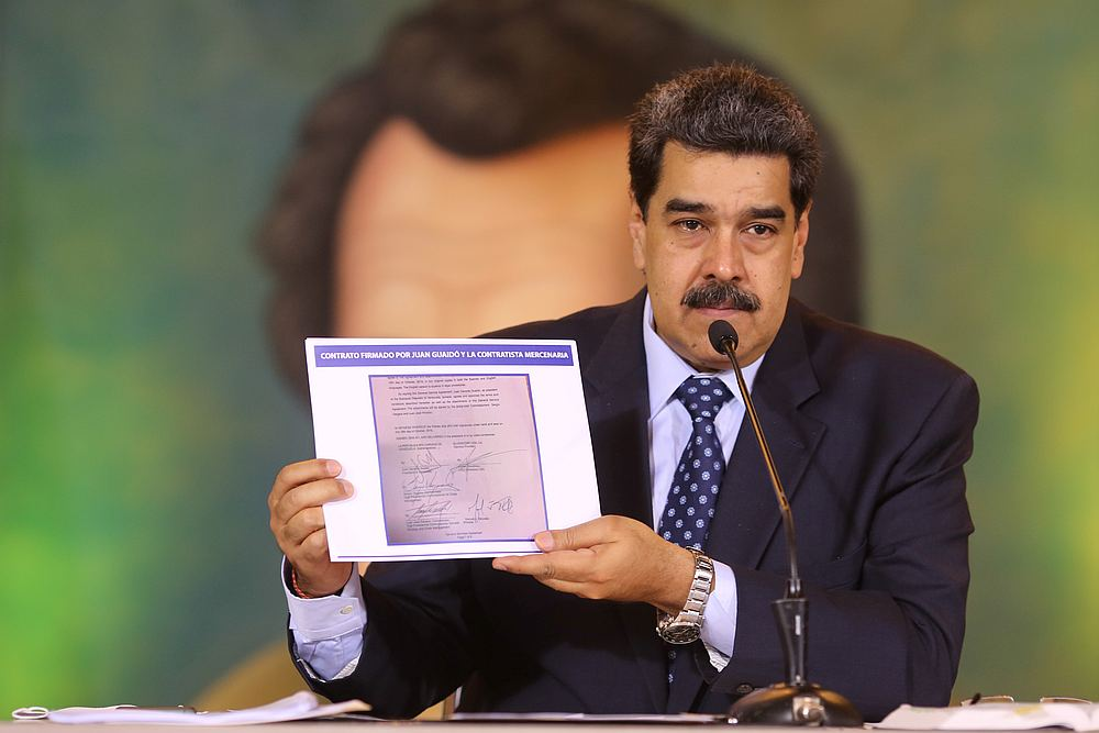 Venezuela's President Nicolas Maduro holds a document during a virtual news conference in Caracas, Venezuela May 6, 2020. — Miraflores Palace handout via Reuters