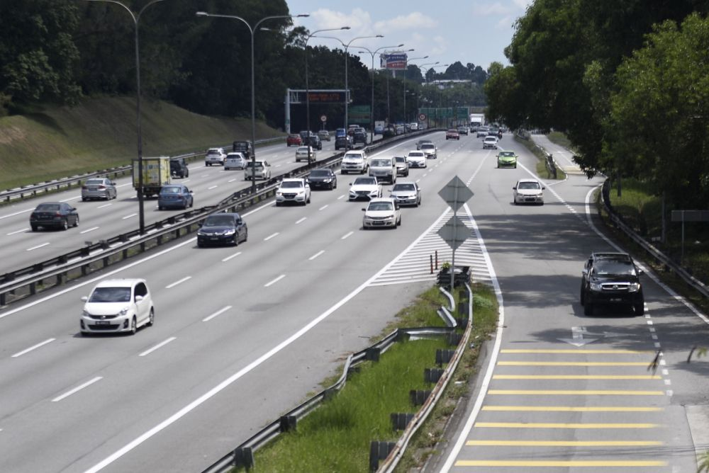 A general view of traffic on the Federal Highway in Shah Alam during the second day of the conditional movement control order May 5, 2020. — Picture by Miera Zulyana