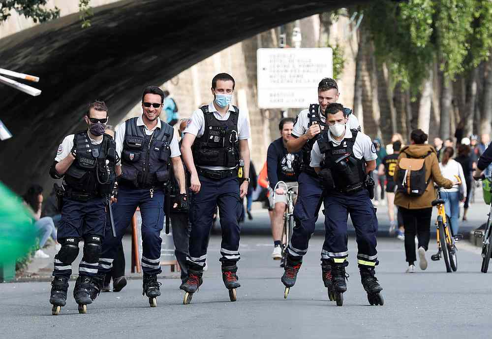 French police on rollerblades patrol along the banks of the Seine after France began a gradual end to a nationwide lockdown due to Covid-19 in Paris, France, May 13, 2020. — Reuters pic