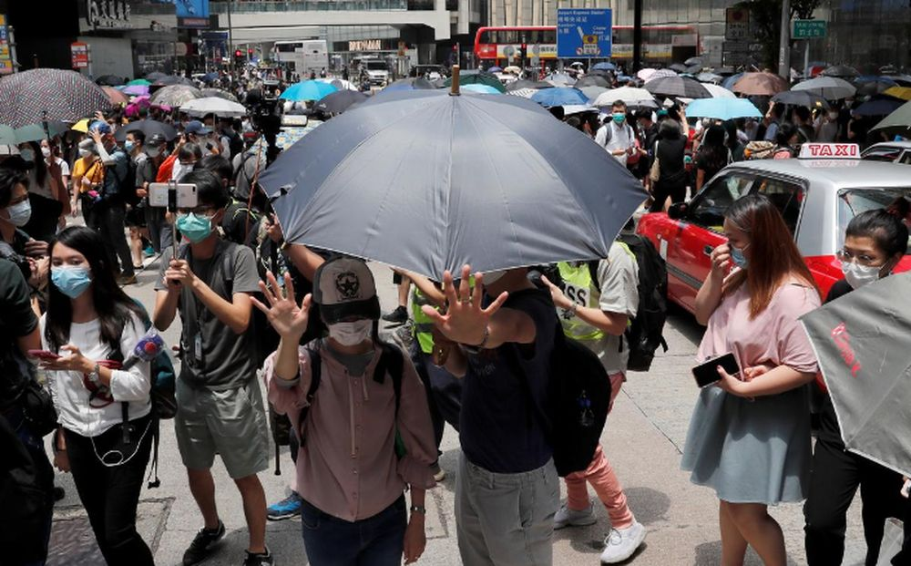 People wearing face masks take part in a protest against the second reading of a controversial national anthem law in Hong Kong, China, May 27, 2020. — Reuters pic