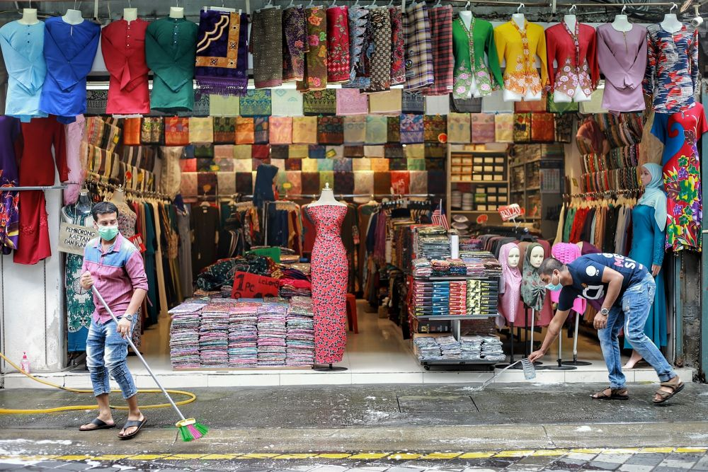A fabric store opens for business on Jalan Masjid India amid the conditional movement control order in Kuala Lumpur May 7, 2020. — Picture by Ahmad Zamzahuri