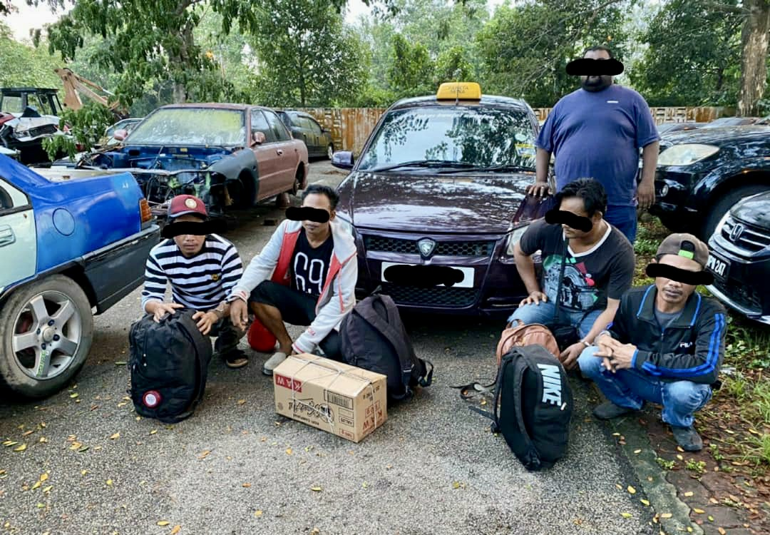 Migrants who were detained trying to illegally exit the country via Johor are pictured during 'Op-Pintas Bersepadu Selatan'. — Picture courtesy of the Johor police