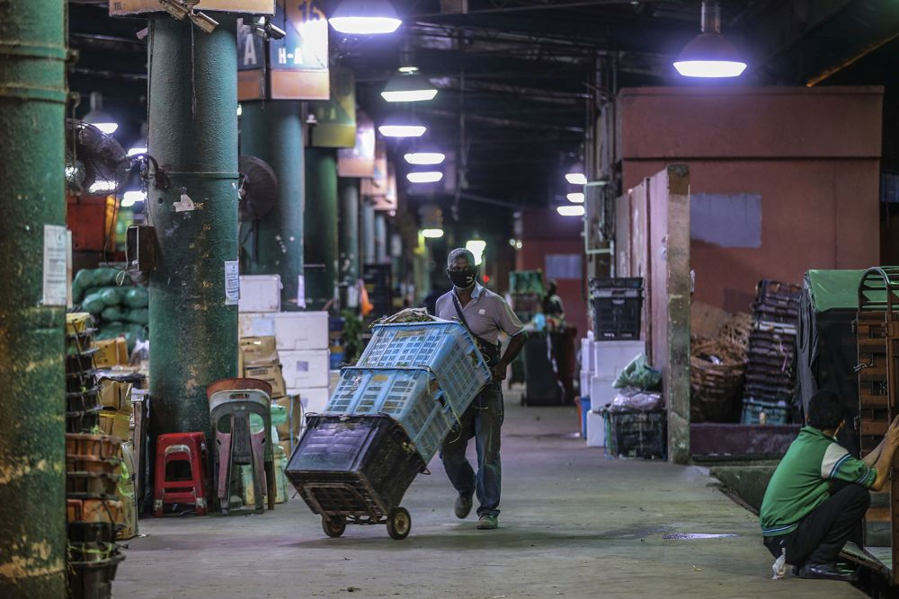 A general view of the Kuala Lumpur wholesale market as traders resume business after the enhanced movement control order on the area was lifted on May 13, 2020. — Picture by Hari Anggara