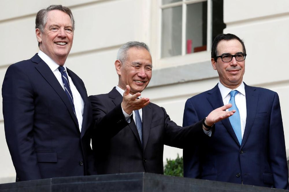 China's Vice Premier Liu He gestures to the media between US Trade Representative Robert Lighthizer (left) and Treasury Secretary Steve Mnuchin before the two countries' trade negotiations in Washington, US, October 10, 2019. — Reuters pic