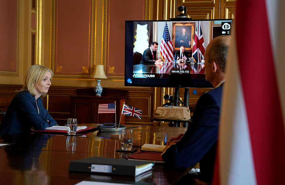 Britain's International Trade Secretary Liz Truss (left) talks remotely from the Foreign Office to the US Trade Representative Robert Lighthizer, in London, Britain May 5, 2020. — 10 Downing Street handout via  Reuters