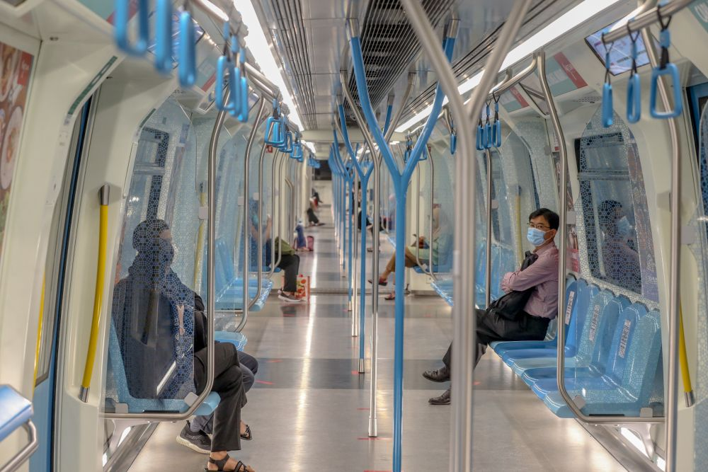 Commuters observe social distancing aboard an MRT train in Kuala Lumpur May 4, 2020. — Picture by Firdaus Latif