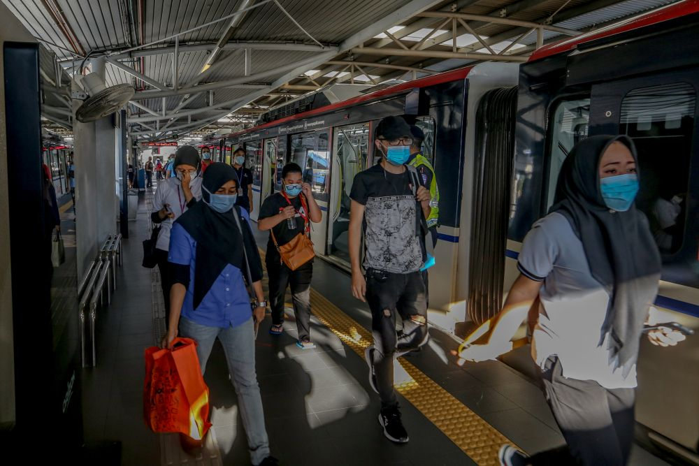 Commuters disembark at the Maluri MRT station on the first day of the conditional movement control order in Kuala Lumpur May 4, 2020. — Picture by Firdaus Latif
