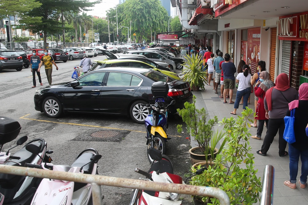 A long queue is seen in front of TMC Bangsar, May 1, 2020. ― Picture by Choo Choy May