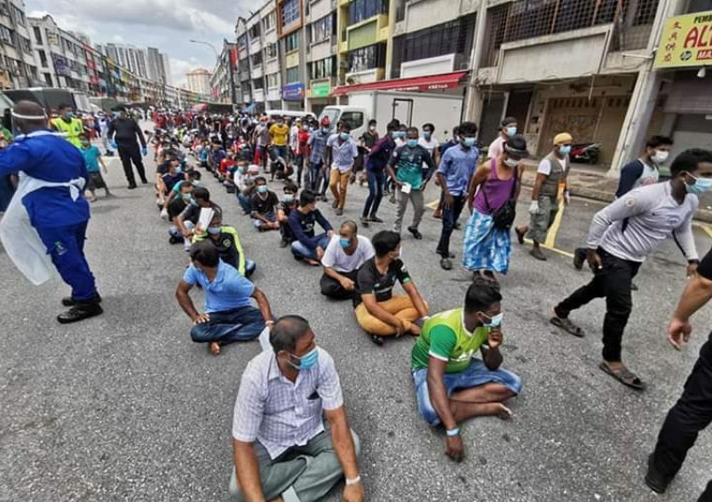 A total of 1,368 illegal immigrants including children were detained by the Immigration Department in raids carried out at the Selayang Wholesale Market, May 12, 2020. — Picture courtesy of Twitter/TV Bernama