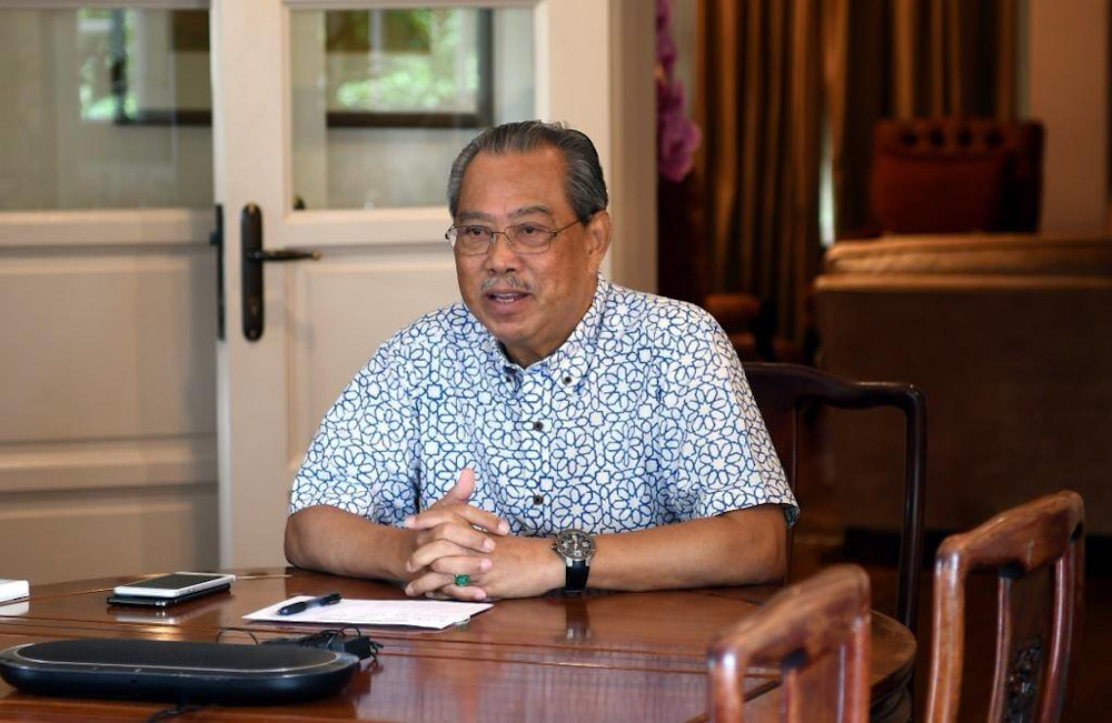 Prime Minister Tan Sri Muhyiddin Yassin said in a posting published at 6pm that he was briefed by Senior Minister Datuk Seri Ismail Sabri Yaakob and Health director-general Dr Noor Hisham Abdullah in a video conference that lasted 40 minutes. — Picture from Facebook/Muhyiddin Yassin