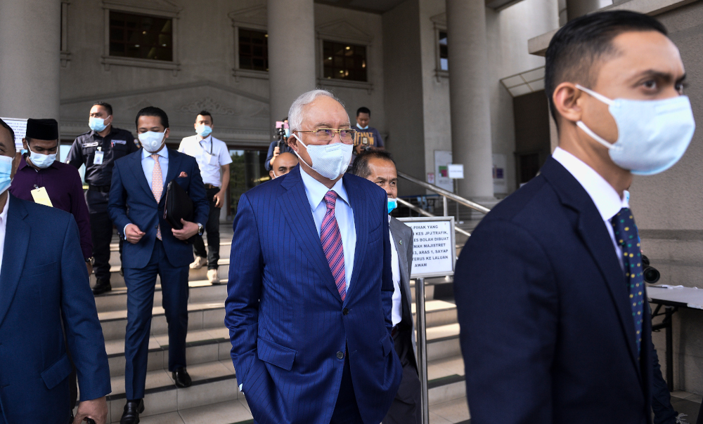 Datuk Seri Najib Razak leaves Kuala Lumpur High Court after his 1MDB trial May 19, 2020. His lawyer today said the former prime minister would never seek to have his criminal cases dropped but will instead want to have his name cleared by going through trial in the courts. — Picture by Miera Zulyana