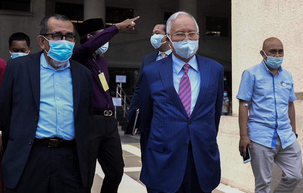 Datuk Seri Najib Razak leaves Kuala Lumpur High Court after his 1MDB trial May 19, 2020. — Picture by Miera Zulyana