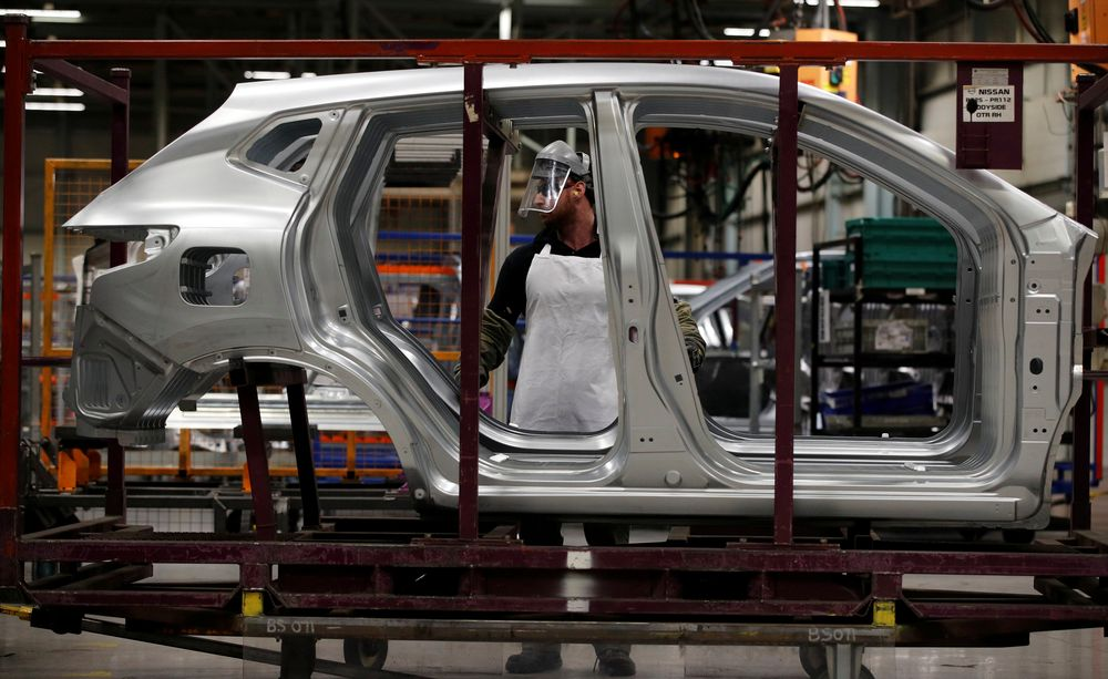 Workers are seen on the production line at Nissan's car plant in Sunderland Britain, October 10, 2019. — Reuters pic