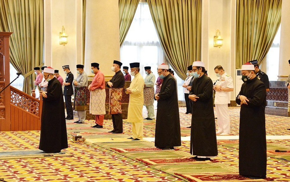 Yang di-Pertuan Agong Al-Sultan Abdullah Ri'ayatuddin Al-Mustafa Billah Shah today performed Aidilfitri prayers in a congregation of 30 people at the main surau of Istana Negara May 24, 2020. — Picture via Facebook/Istana Negara
