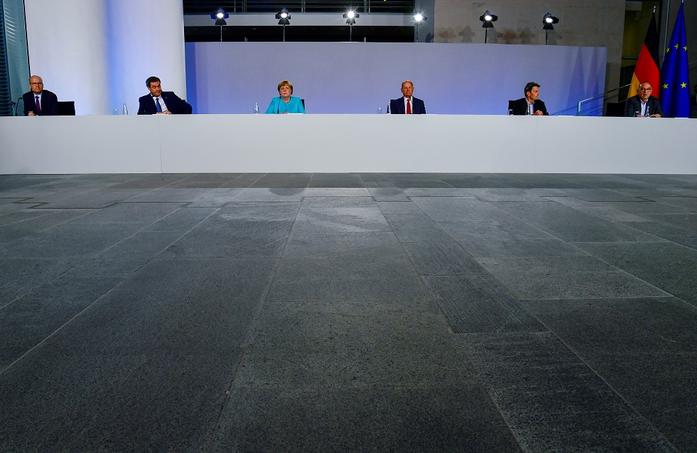 German Chancellor Angela Merkel (third left) at a news conference after coalition meetings over stimulus measures to reboot post-coronavirus economy, in Berlin June 3, 2020. After 17 hours of discussion, the parliamentary finance committee today approved a total of €179.8 billion of new debt for next year. — Reuters pic