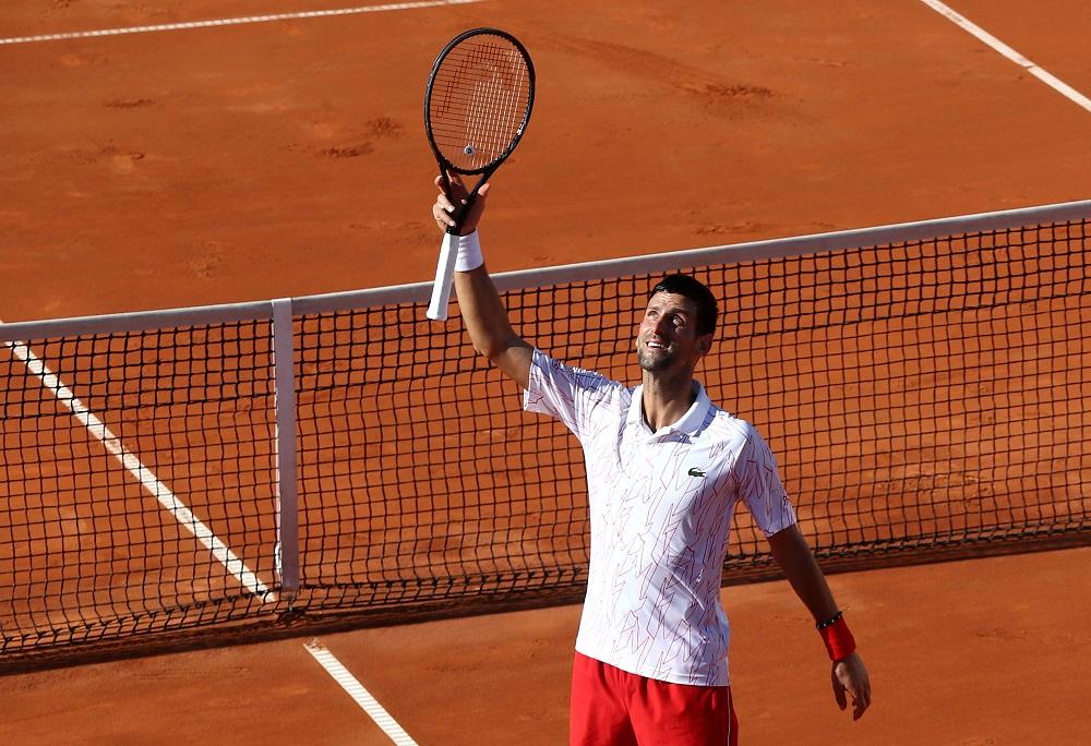 Serbia's Novak Djokovic celebrates winning his match against Germany's Alexander Zverev in Belgrade June 14, 2020. — Reuters pic