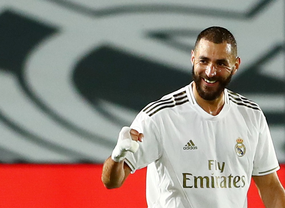 Karim Benzema was caught on camera criticising strike partner Vinicius Jr. — Reuters pic